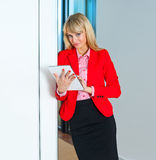 Business woman in office corridor with tablet computer Stock Photos