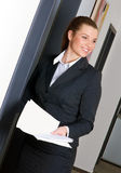 Business woman at office door Royalty Free Stock Image