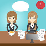Business woman in the office. Business woman eating and business woman working in the office Stock Photo