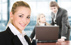 Business woman in an office environment. Business women in an office environment with team stock photo