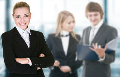 Business woman in an office environment. Business women in an office environment with team stock image