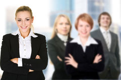 Business woman in an office environment. Business women in an office environment with team royalty free stock photography