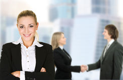 Business woman in an office environment. Business women in an office environment with team royalty free stock images