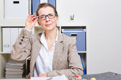 Business woman in office with glasses Stock Photography