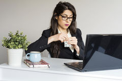 Business woman in office with headache Stock Photo