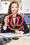 Business woman in office holding Royalty Free Stock Photos