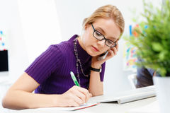 Business woman in office holding mobile phone Stock Photography
