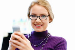 Business woman in office holding mobile phone Stock Photos