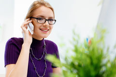 Business woman in office holding mobile phone Stock Image