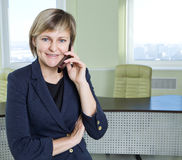Business woman in office interior Royalty Free Stock Photo