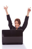 Business woman in office jubilates at desk Royalty Free Stock Image