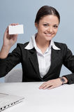 Business woman in office palce show white card Stock Photos