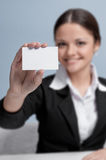 Business woman in office palce show white card Stock Images