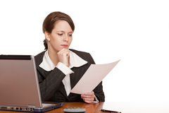 Business woman in office reading contract Stock Images