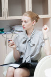 Business woman in the office. Serious business woman in the office royalty free stock photo