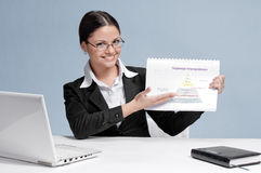 Business woman in office show chart Stock Photo