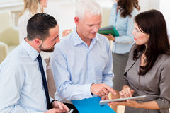 Business woman in office showing boss presentation Royalty Free Stock Photos