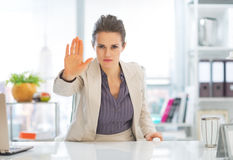 Business woman in office showing stop gesture Royalty Free Stock Photography