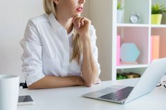 Woman at office sitting at her desk and concentrating. Business woman at office sitting at her desk and concentrating royalty free stock photo