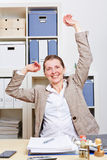 Business woman in office stretching Royalty Free Stock Photography