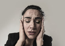 Business woman in office suit suffering migraine pain and strong headache Royalty Free Stock Photo