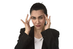 Business woman in office suit suffering migraine pain and strong headache with fingers on her tempo Stock Photography