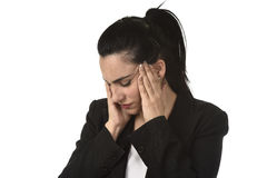 Business woman in office suit suffering migraine pain and strong headache with fingers on her tempo Stock Images
