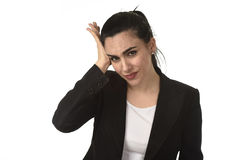 Business woman in office suit suffering migraine pain and strong headache with fingers on her tempo Royalty Free Stock Photography