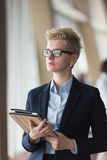 Business woman  at office with tablet  in front  as team leader Royalty Free Stock Photography