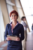 Business woman  at office with tablet  in front  as team leader Stock Photos