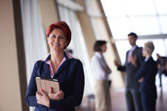Business woman  at office with tablet  in front  as team leader Stock Photo