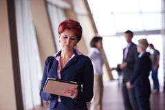 Business woman  at office with tablet  in front  as team leader Royalty Free Stock Image