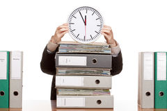 Business woman in office under time pressure. Business woman in office with folder stacks is under time pressure. Isolated on white background Royalty Free Stock Image