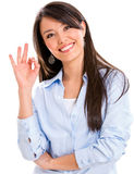 Business woman with an ok sign Royalty Free Stock Photo