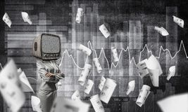 Business woman with old TV instead of head. Business woman in suit with old TV instead of head keeping arms crossed while standing against flying papers and Royalty Free Stock Photo