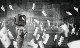 Business woman with old TV instead of head. Business woman in suit with old TV instead of head keeping arms crossed while standing against flying papers and Stock Images
