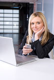 Business Woman On Cell At Desk Royalty Free Stock Image