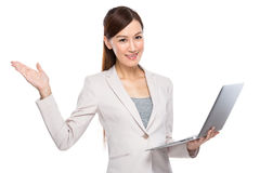 Business woman open hand palm with laptop computer Royalty Free Stock Image