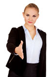 Business woman with an open hand ready for handshake Royalty Free Stock Photos