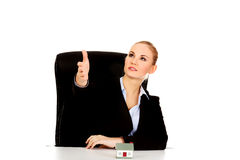 Business woman with an open hand ready for handshake and house model on the desk Royalty Free Stock Image