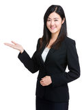 Business woman with open palm Stock Photos