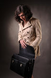 Business woman opening a suitcase Stock Photos