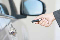 Business woman operate remote key car Stock Photo