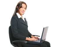 Business Woman Operator. Business Woman working in the computer and talking by headset Royalty Free Stock Photography