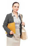 Business woman with an orange binder Royalty Free Stock Photo