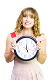 Business woman out of time. Attractive young blonde business woman clutches clock showing time as five oclock in a time to stop work conceptual of being out of Royalty Free Stock Photo