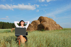 Business Woman Outdoor. Young attractive girl with  laptop on  rural field Royalty Free Stock Photo