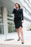 Business Woman Outdoors on Cell Phone Royalty Free Stock Photography