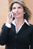 Business Woman Outdoors on Cell Phone Royalty Free Stock Images