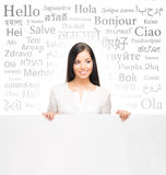 Business woman over the background with a different world langua Royalty Free Stock Photo